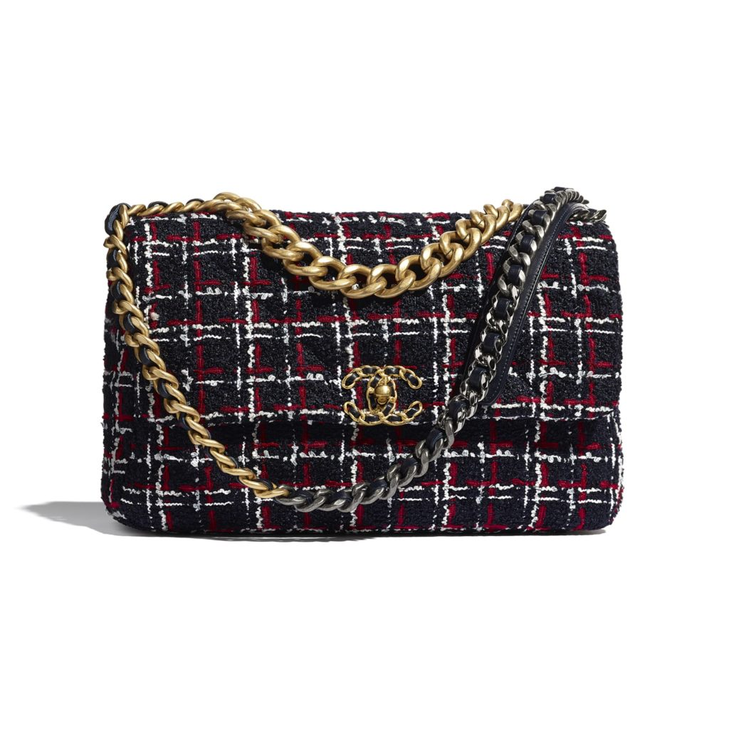 Chanel 19 Large Flap Bag in metal, navy blue, white and red; $4,600, chanel.com