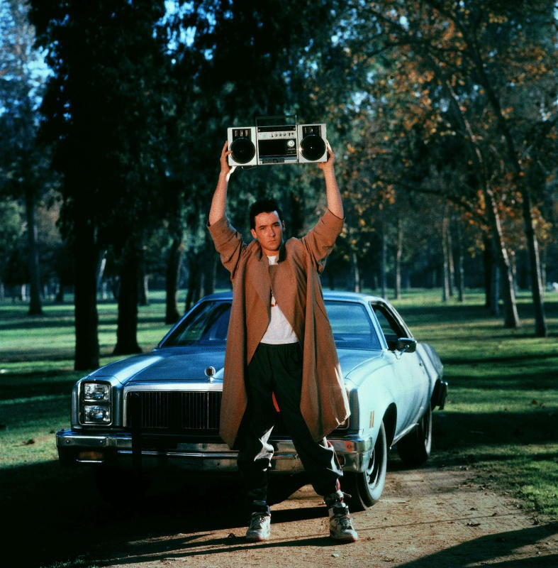 John Cusack stars as Lloyd Dobbler in the iconic 80's film, seen here in his most famous shot.
