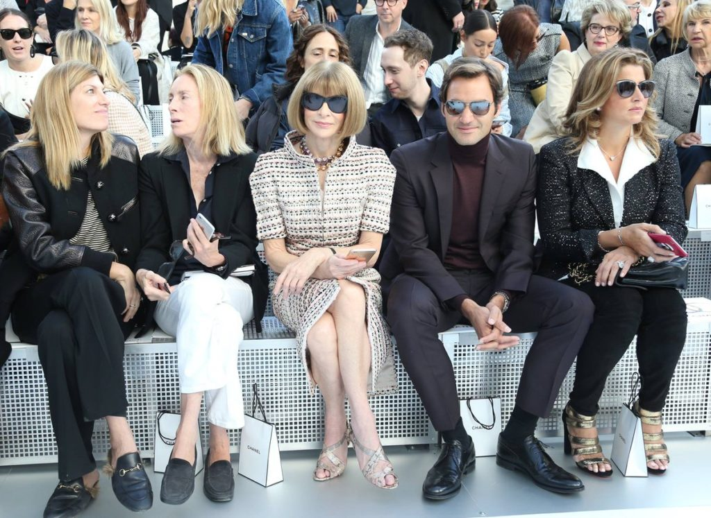 Anna Wintour sits on the front row of the Chanel show with Roger Federer and his wife, Mirka.
