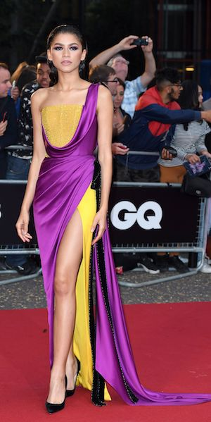 Zendaya stuns in this violet and yellow draped gown by Ralph & Russo at the 2018 GQ Men of the Year Awards.