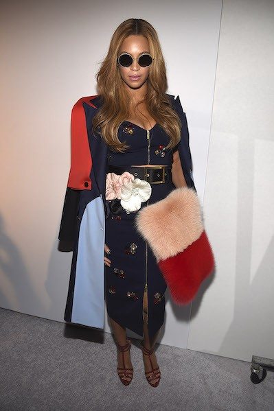 Beyoncé stuns in a subtly triadic look of red, blue,  and yellow in this ensemble by Harbison at New York Fashion Week 2015.