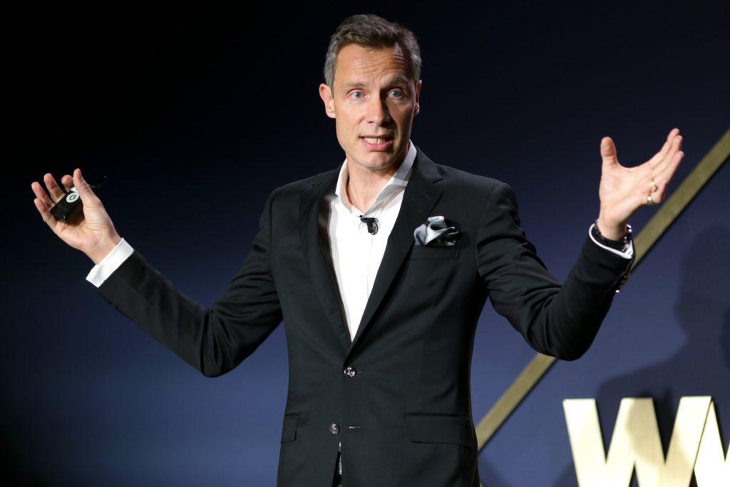 Neiman Marcus CEO Geoffroy van Raemdonck speaking at a Women's Wear Daily (WWD) event.