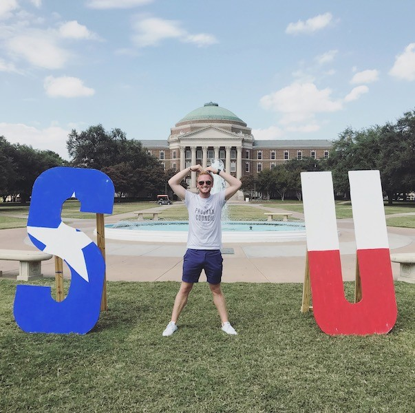 """Jack respresenting the """"M"""" in an SMU sign"""