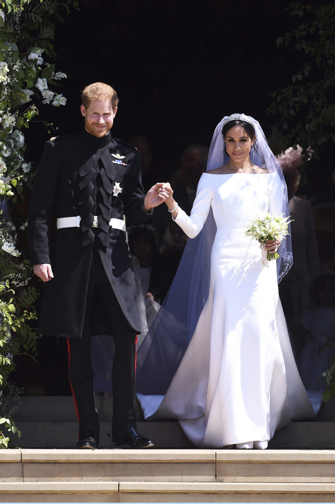 Prince Harry and Meghan Markle exit St George's Chapel in Windsor Castle, Markle wearing her famously simple Givenchy wedding dress.