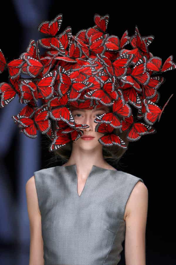 """A model wears a butterfly headpiece in the designer&squot;s Spring/Summer 2008 show, """"La Dame Bleue."""""""