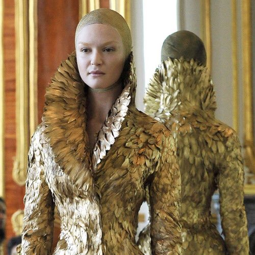 """The iconic gold feather coat in the designer&squot;s final collection, """"Angels and Demons,"""" Fall/Winter 2010."""