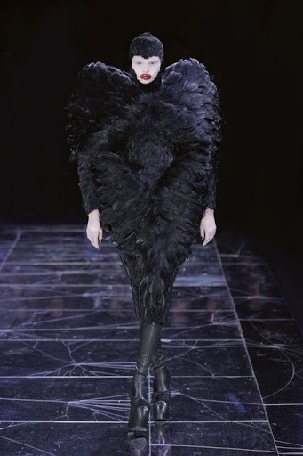 """A model walks in McQueen&squot;s infamous Fall/Winter 2009 show, """"The Horn of Plenty,"""" one of the designer&squot;s darkest collections."""