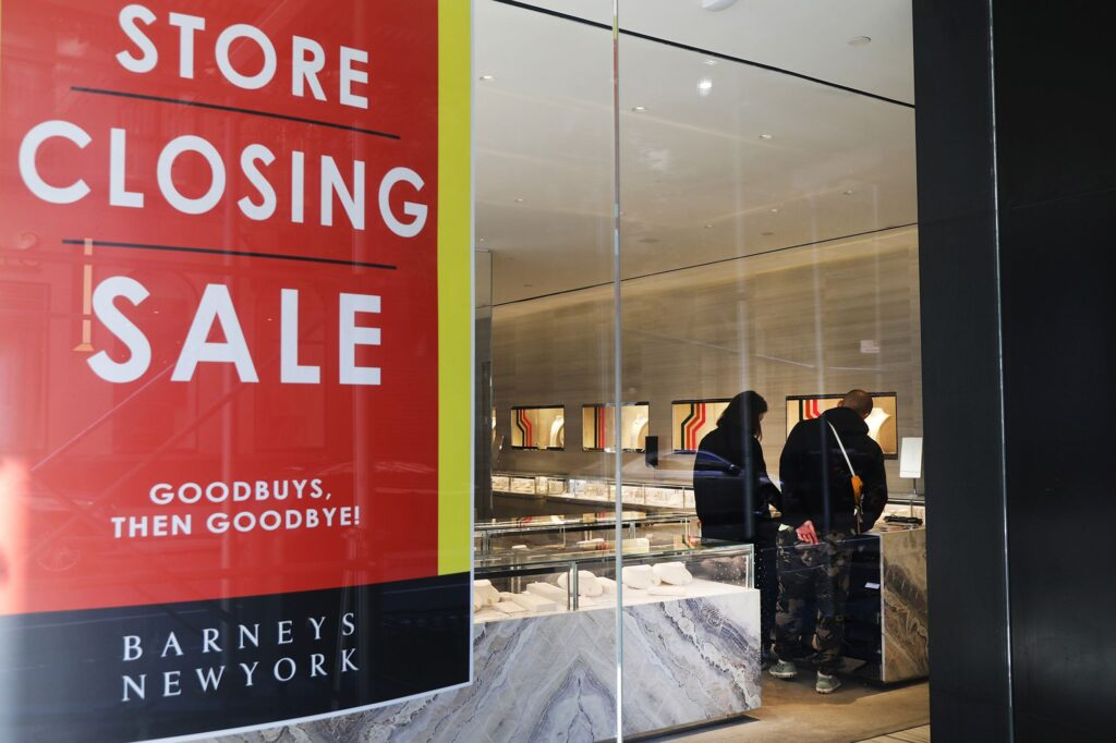 A couple shops Barneys New York's going-out-of-business sale in 2019.