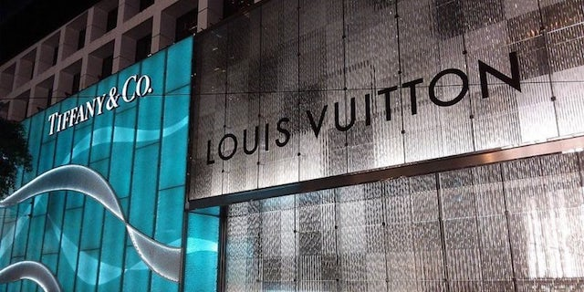 A Louis Vuitton and Tiffany & Co. store side by side.