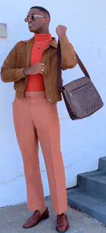 Influencer Wisdom Kaye let the bold orange of his sweater vest stand out amidst similar but muted colors.