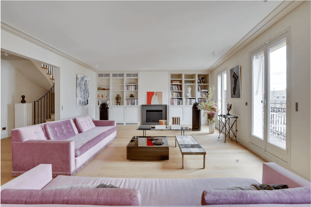 Natural light, pink velvet couches, and views for days make this living room the perfect spot to unwind.