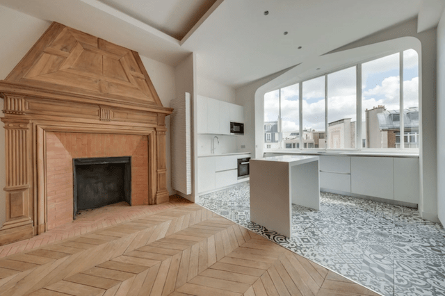 An original fireplace and modern kitchen fit perfectly.