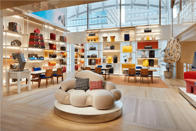Louis Vuitton's New York flagship, with pieces from artist Jun Aoki. Louis Vuitton frequently brings in artists to redesign their stores for the season in order to create a unique customer experience.