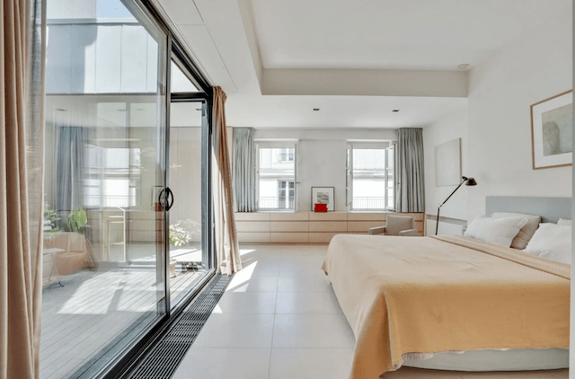 Clean, minimal, and glowing with sunlight. This is the ideal bedroom.
