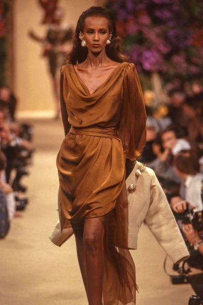 Iman in a camel-colored silk dress for Yves Saint Laurent 1989.