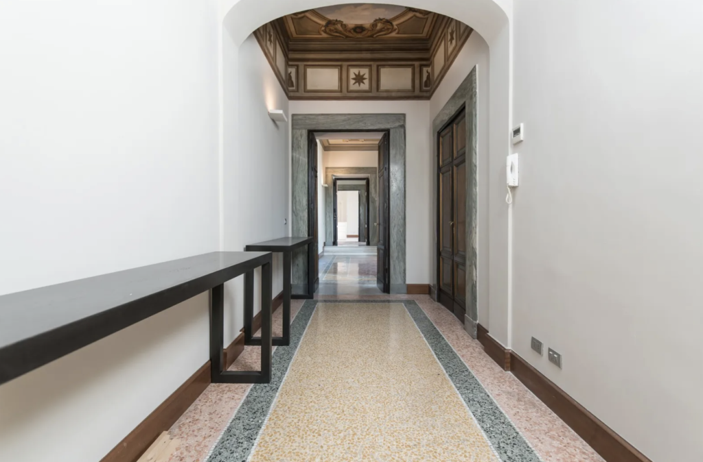 All this hallway needs is some modern ambient lighting, some warm furnishings, and a coffee table book, of course.