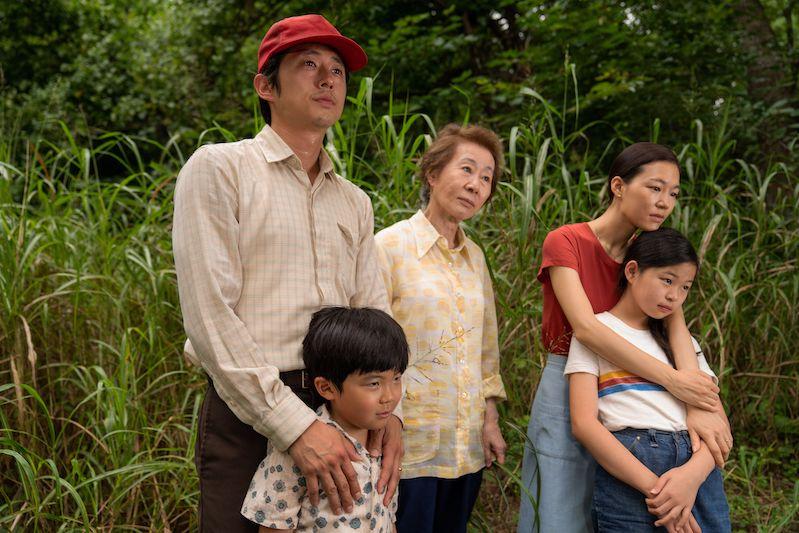 Steven Yeun, Youn Yuh-jung, and Han Ye-ri (L-R) stand behind Alan Kim and Noel Kate Cho (L-R) in Minari.